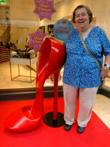 Maureen was intrigued by this giant shoe, reminding her of Mardi Gras and the Krew of Muses
