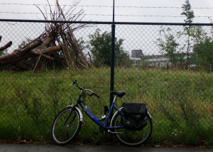 There is still a little open land in the city center as depicted by this rain-soaked bicycle.