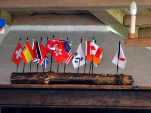 Little flags in a log mark the origins of guests visiting Our Chalet on any given day.