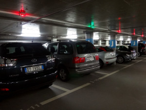 Parking garages are easy to find, clean, and automated. Red lights indicate the parking spot is taken, green lights tells you the spot is free. Check out is also automated with machines and instructions located on each level of the garages.
