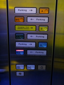 Parking garage elevator - easy to understand and almost always in English