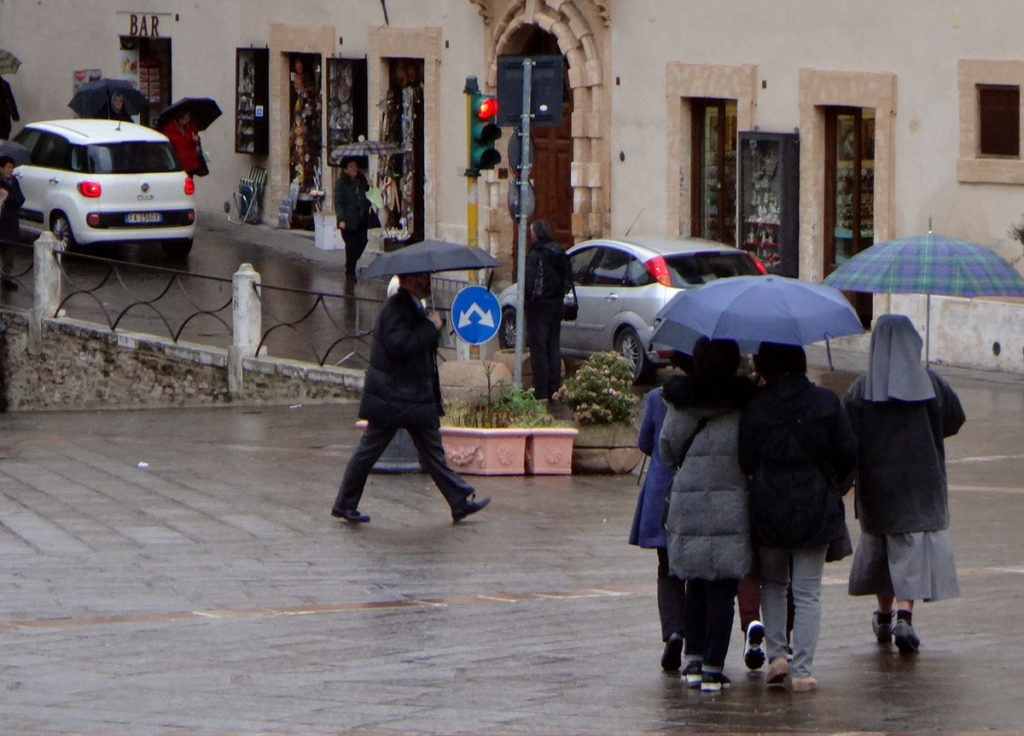 Tourists in the rain. Assissi, Italy 2016
