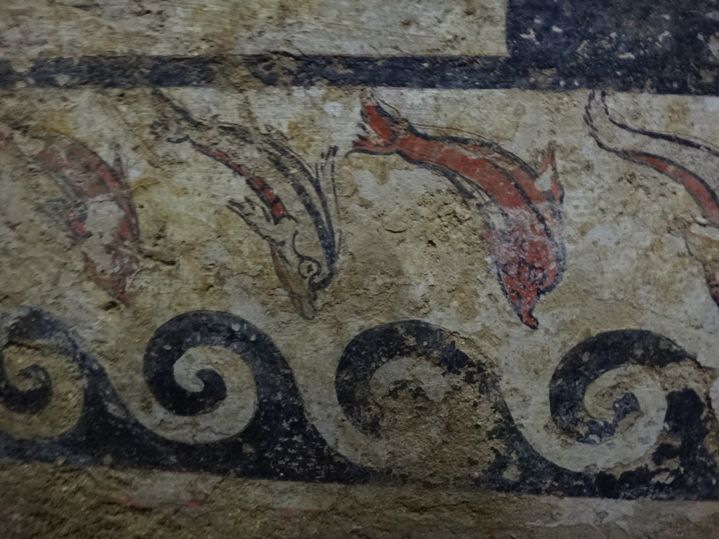 The diving dolphins represent the human dive into the afterlife. The Etruscans were extraordinary merchants and many took to the sea so they would know dolphins. Museo Civico Archeologico di Sarteano