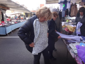 My sister Terry checks out pajamas at the Marsciano Market.