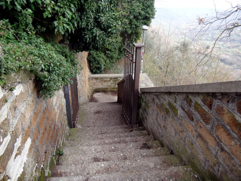 This is the start of the long stairway that leads to the footbridge to Civita. Civita, Italy 2016.