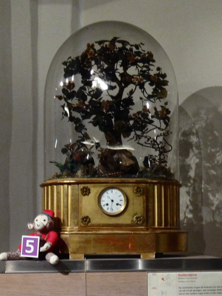 This music box/clock plays a sweet little tune as birds twirp in the trees.