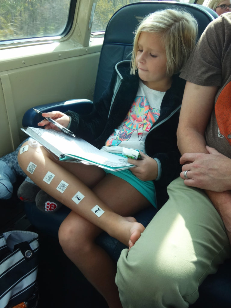 Maddy journaling her trip through the Cuyahoga Valley National Park.