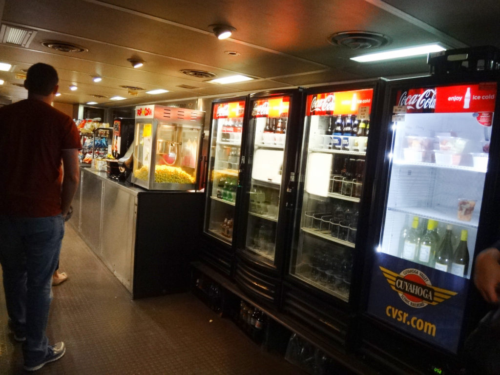 There is a food car on the train where you can buy vending snacks or food at a snack bar. The train also features full breakfast (buy your tickets ahead of time) and frequent dinner trips.