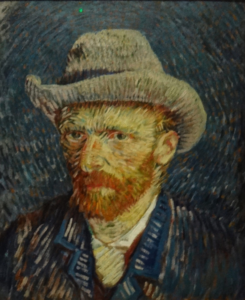 "Self portrait with Grey Felt hat, 1887. A museum display says the painting is, ""very accomplished and portrays a more elegant van Gogh (than an earlier self portrait). It is well-considered and neo-impressionist experiment in his new modern style and technique, executed in strong, contrasting colors and expressive brushstrokes."""