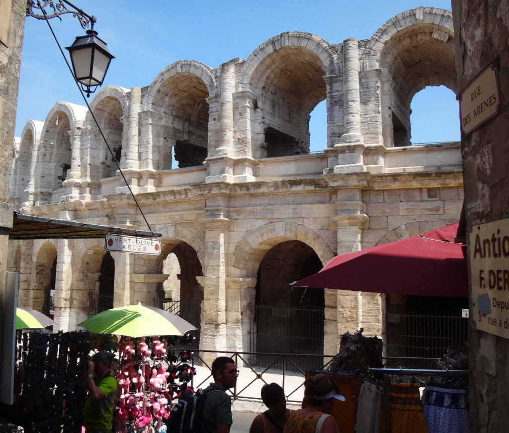You can see that modern entrepreneurism sits cheek to jowl to the ancient coliseum. Arles, France