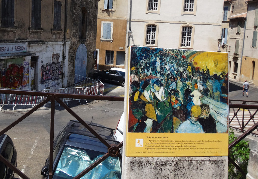"Van Gogh sat next to the coliseum in Arles and painted the crowds as they swarmed after an event. This is where he painted the Arena at Arles in 1888. The sign says: ""I saw bullfights in the arena, or rather sham fighting ... Only the crowd was wonderful, the large, colorful crowd, superimposed two and three stories of steps with the effect of sun and shade of the huge circle. This painting is at the Hermitage in St. Petersburg, Russia."