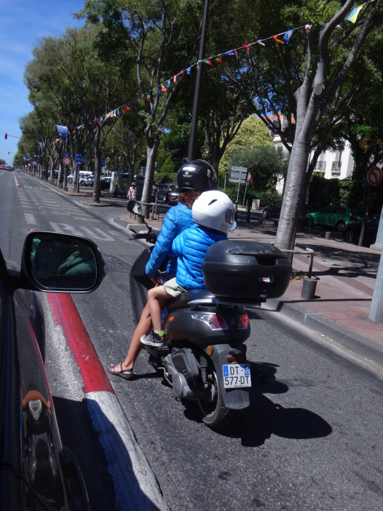 We saw many children riding behind their parents on scooters and motorcycles in Marseilles. Not many bicycles here, but lots of different kinds of motor vehicles.