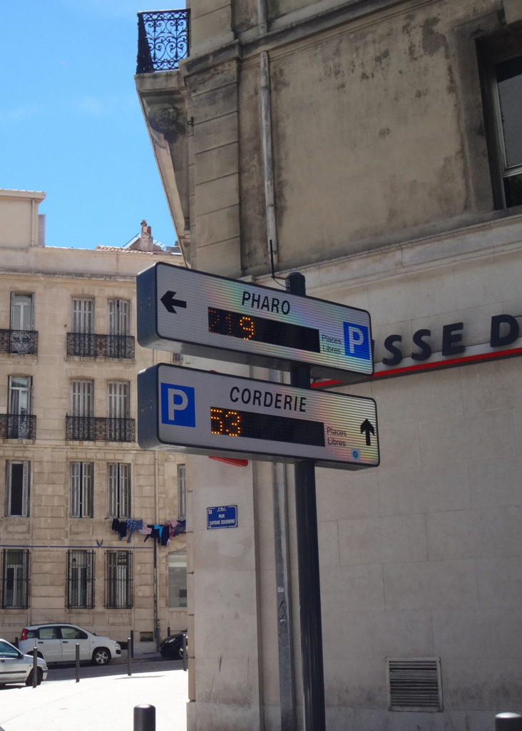Parking garages indicate how many empty spots are available on each level. Marseille, France